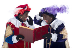 Zwarte Piet and the book of Sinterklaas Stock Images