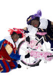 Zwarte Piet finds a gingernut in his tire Royalty Free Stock Photo