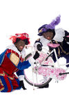Zwarte Piet finds a gingernut in his tire Royalty Free Stock Photos