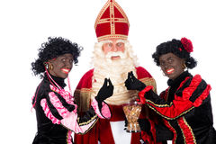 Zwarte Piet giving pepernoten (cookies) to Sinterklaas Stock Images
