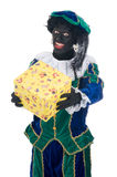 Zwarte Piet giving a present Stock Photography