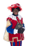 Zwarte Piet with his book Stock Images