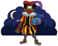 Zwarte Piet Holding a present Stock Images
