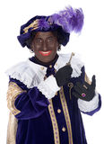 Zwarte Piet and a key of the house of Sinterklaas Stock Images