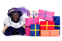 Zwarte Piet with a lot of presents stock photography