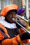 Zwarte Piet playing trombone Royalty Free Stock Photos