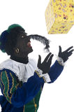 Zwarte Piet with present Stock Photography