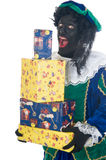 Zwarte Piet with presents Stock Photography