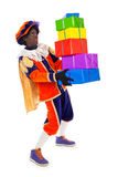 Zwarte piet with presents (black pete). Zwarte piet.clipping path included  .typical Dutch character part of a traditional event celebrating the birthday of Stock Image