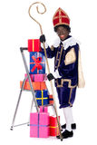 Zwarte Piet with presents Stock Images