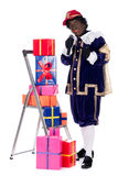 Zwarte Piet with presents Royalty Free Stock Photos