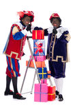 Zwarte Piet with presents Royalty Free Stock Images