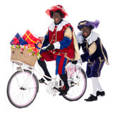 Zwarte Piet with presents Stock Photos