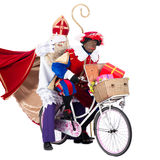 Zwarte Piet and Sinterklaas on a bike stock photography