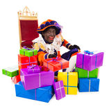Zwarte piet sinterklaas (black pete). Zwarte piet ( black pete)  with presents .clipping path included. typical Dutch character part of a traditional event Royalty Free Stock Photos