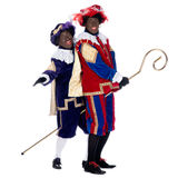 Zwarte Piet and the staff of Sinterklaas Stock Photos