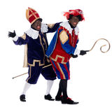 Zwarte Piet and the staff of Sinterklaas Royalty Free Stock Images