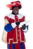Zwarte Piet with a tablet Stock Images
