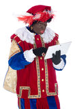 Zwarte Piet with a tablet Royalty Free Stock Photos