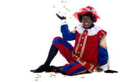 Zwarte Piet is throwing ginger nuts Stock Photo