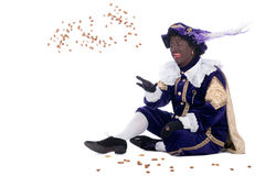 Zwarte Piet is throwing ginger nuts Royalty Free Stock Photos