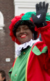 Zwarte Piet waving to the kids Royalty Free Stock Photography