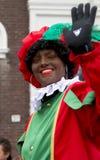 Zwarte Piet waving to the kids Royalty Free Stock Photography