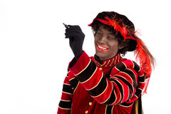 Zwarte Piet writing message ,Sinterklaas (black pete) Royalty Free Stock Photos
