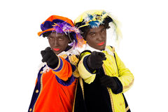 Zwarte pieten  (black pete). Zwarte pieten.clipping path included  .typical Dutch character part of a traditional event celebrating the birthday of Sinterklaas Royalty Free Stock Photography