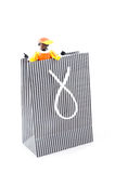 Zwarte pieten in a shopping bag,. Characters from a traditional dutch holiday; isolated on white Royalty Free Stock Photography