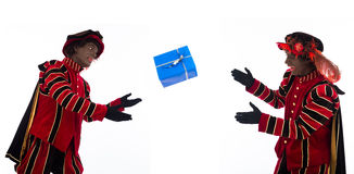 Zwarte Pieten throwing gift Stock Photos