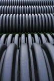 Zwarte plastic kromlijnige pvc-pijp royalty-vrije stock foto