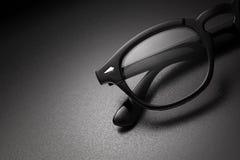 Zwarte plastic oogglazen met exemplaarruimte stock foto