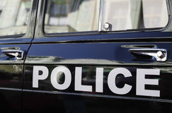Zwarte politiewagen stock afbeelding