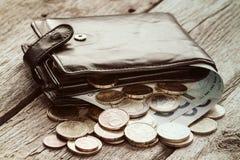 Zwarte portefeuille met euro munt Stock Foto