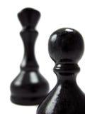Zwarte pown en koningin stock foto's