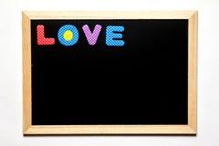 Zwarte raad met de verwoording van liefde op witte achtergrond Stock Fotografie