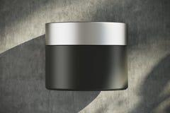 Zwarte roomcontainer met een zilveren deksel Royalty-vrije Stock Fotografie
