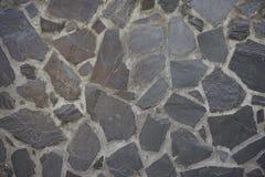 zwarte rotsmuur Stock Afbeelding