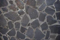 zwarte rotsmuur Stock Afbeeldingen