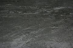 Zwarte rotstextuur met dalingen Royalty-vrije Stock Afbeeldingen