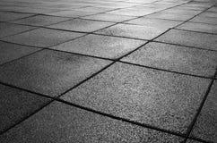 Zwarte rubbervierkanten Stock Foto