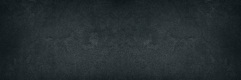 Zwarte ruwe concrete muur brede textuur - donkere grungeachtergrond