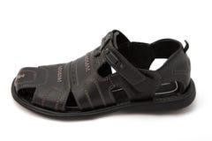 Zwarte sandals op wit Stock Afbeelding