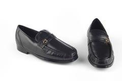 Zwarte sandals van het kleurenleer Stock Foto's
