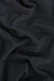 Zwarte satijnachtergrond Royalty-vrije Stock Foto's