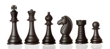 Zwarte schaakstukken in volgorde van het verminderen stock afbeelding
