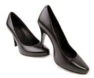 Zwarte schoenen die op wit worden geïsoleerdo stock fotografie