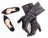 Zwarte schoenen en laarzen royalty-vrije stock foto