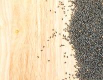 Zwarte Sesamzaden op Houten Achtergrond met Ruimte voor Tekst Stock Fotografie